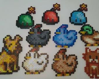 Various Stardew Valley fuse bead art/fridge magnets