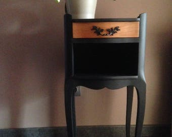 Matte black baroque bedside table