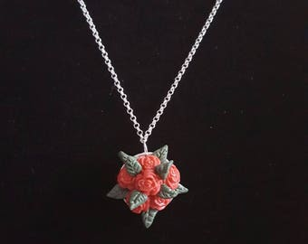 A really sweet and dainty hand crafted rose bouquet pendant on a  silver chain necklace.