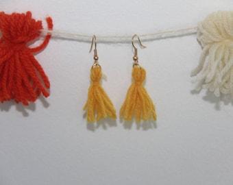 Mustard-colored tassel earring