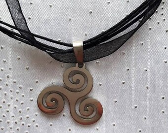 The Triskelion symbol and black organza necklace