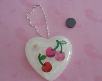 Resin creation with cherries and strawberries