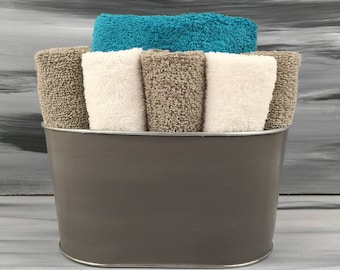 Gray Bathroom Towel/Wash Cloth Bin with  1 teal hand towel, 5 white and 5 gray wash cloths.