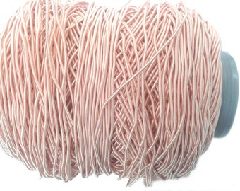 Rigid lace or braid trimming of the salmon pink color