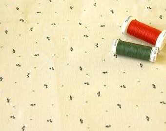 Patchwork fabric with fine patterns of red and green Holly
