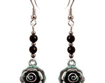 discreet flower chic silver reliefs and small black beads