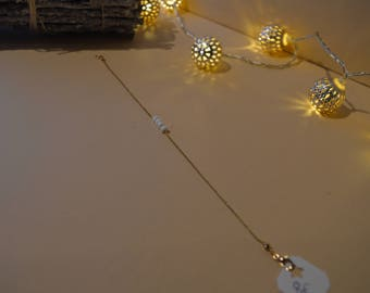 Bracelet chain and white beads