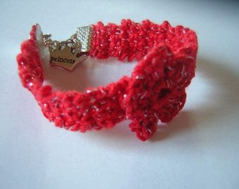 Red bracelet sparkling with flower for the holidays!