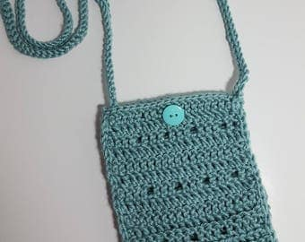 Crocheted light aqual colored cross-body purse