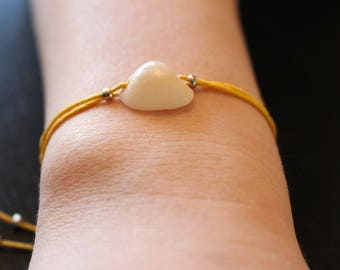 Shell bracelet and silver beads