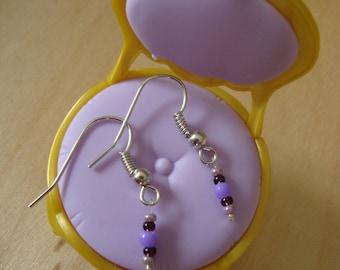 Pearl Earrings in shades of violet purple