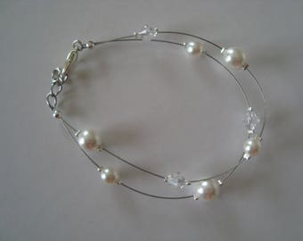 Double wedding bracelet in white and transparent beads