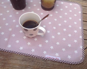Placemat in oilcloth with pink stars