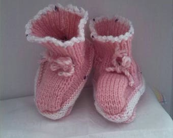 Baby pink hand-knitted booties