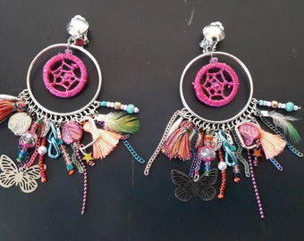 Earrings with tassels, natural feather and charms