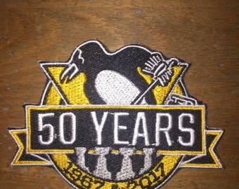 NHL hockey Pittsburgh penguins  50 years puck squid ice zamboni Mario Lemieux