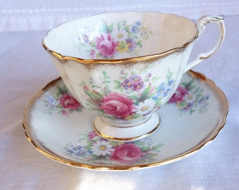 Paragon Rose and Floral Spray Heavy Gold Cup and Saucer By Appointment to Her Majesty the Queen