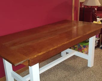 Reclaimed Cherry Hardwood Farmtable. 75 long x 35 wide x 31 high. Legs are reclaimed poplar painted white. Free delivery up to 100 miles.