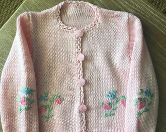 Pink, handmade, knitted sweater for a  6-12 month old baby girl.