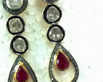 Air ring with ruby and diamond