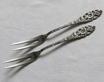Nice pair of Dutch floral Ajour pierced stainless steel pickle forks. Made by Sola Zeist Holland 1950s.