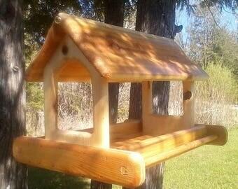 very large hanging cedar wood fly through platform bird feeder tbnup