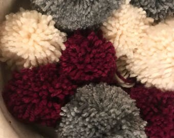 Collection of 8 pom-poms in a range of sizes to be used for decoration