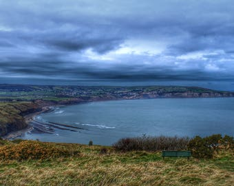 View Robin Hoods bay from Ravenscar North Yorkshire.A4 mounted print .  Moody skies