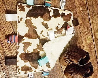 Cowprint and Sherpa Tag Blanket