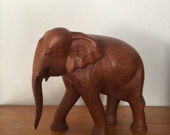 Carved wood elephant, wood elephant.