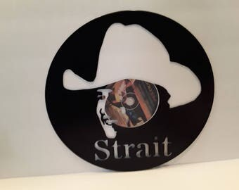Greorge Strait hand cut on vinyl record.
