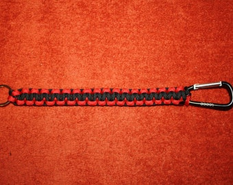 New has 8' of black/red 550 ParaCord keychain and carabener.