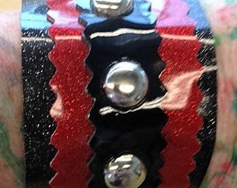 Sale!! Cool studded vinyl cuff in red and black sparkle vinyl