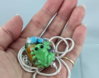green glass frog necklace, sterling silver necklace, frog jewelry, glass frog, multicoloured floral bead, amphibian jewelry, julie vanember
