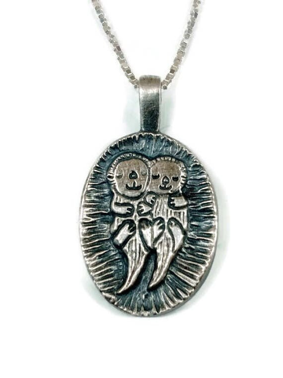 Otter necklace lets hold hands sterling like this item aloadofball Image collections