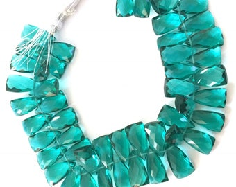 1/2 strand of caribbean green colored  long triangles 25.00
