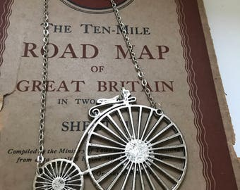 Gorgeous penny farthing bicycle necklace