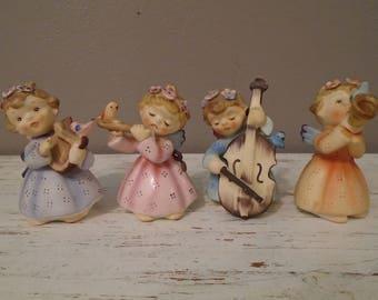 Complete set of vintage Lefton musical angels No. 149, pink, blue, lavender, peach with, lyre, cello, flute, and trumpet / vintage angels