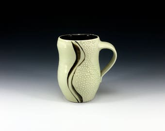 Pale sage green glazed curvy porcelain mug with slip trailed dots. Handmade porcelain pottery cup for coffee, tea or cocoa (#1)