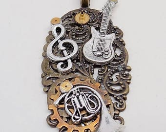 Steampunk jewelry Steampunk guitar and angel wing necklace pendant.