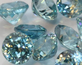 One Sky Blue Zircon Accent Gem 4.5 mm Precision Cut Round Average .50 carat each