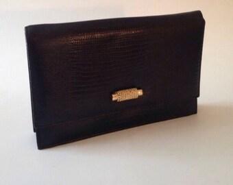 Vintage black and gold tone convertible clutch or shoulder bag
