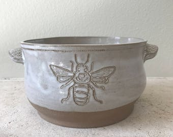 Carved bee casserole dish