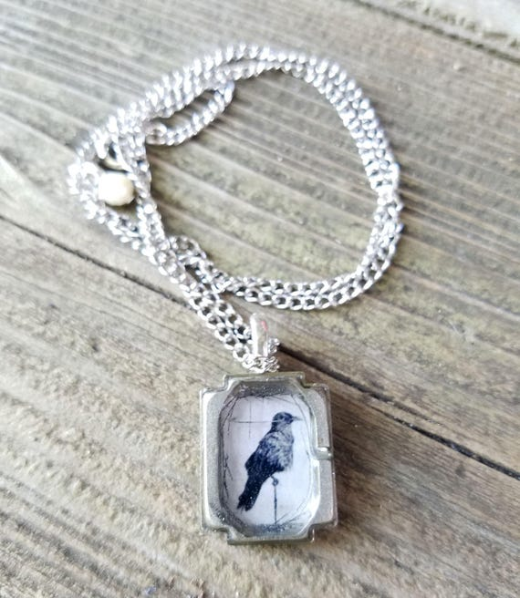 Crow - upcycled metal and resin pendant with old watch parts