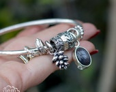 Sterling silver chunky bangle with cast succulent and black sunstone - Spinner of Yarns series -