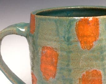 Stoneware Pitcher; Functional Ceramic Arts; Celadon Glaze; Orange Accents