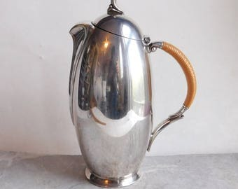 Vintage 1847 Rogers Bros FLAIR Mid-Century Modern Coffee Pot w/ Rattan Handle - 1950s Silver Plate Serving Piece - Tall Bullet-Shaped
