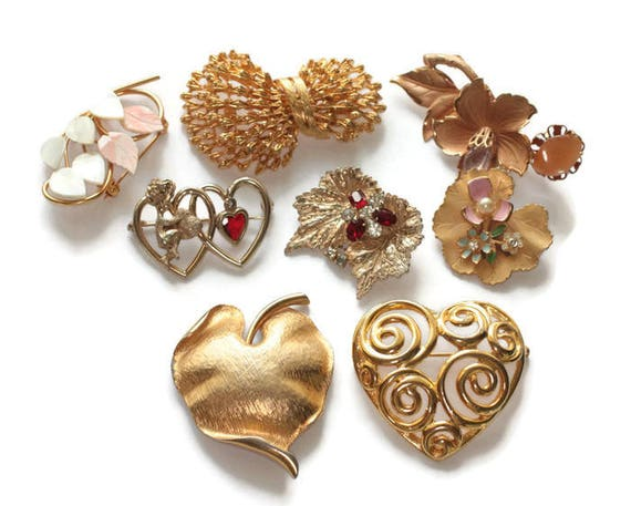 Eight Brooch Lot Gold Tone Hearts Corocraft Scitarelli MOP Floral Mid Century Jewelry