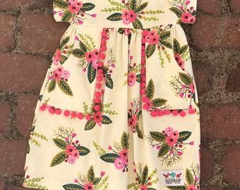 Floral dress with pom pom