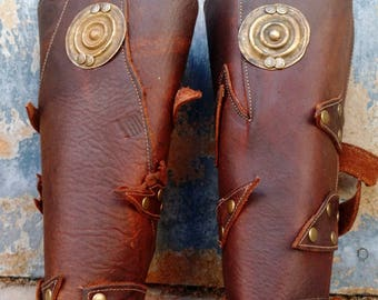 Primitive Oiled Brown Leather Peaked Bracer Pair 2 with Brass Ethiopian Shield & Antiqued Brass Accents